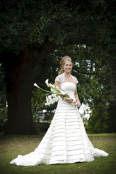 Wedding dress size 8 ivory,  layered with beaded bust,  shall & straps